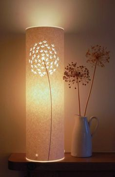 """This elegant Allium table lamp was inspired by the beautiful purple Allium flowers in my Mum's garden. The flower head is laser cut engraved and has very intri"