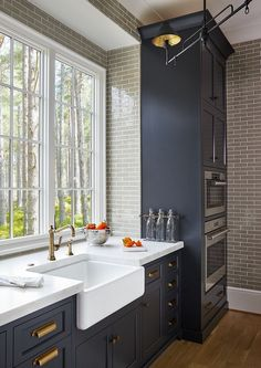 Kitchen backsplash and scullery walls are Walker Zanger's Gramercy Park crackled tile in Pipe Smoke #bathroomsinkstyles