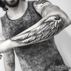 This lower arm wing is a minimal concept. Done in black ink, it has little detail; however the shadows create the illusion of depth making the design an absolutely striking piece of art. 3d Tattoos, Forearm Tattoos, Unique Tattoos, Body Art Tattoos, Sleeve Tattoos, Cool Tattoos, Wing Tattoos, Tatoos, Tattoo Wings
