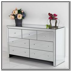 large mirrored chest of drawers with 7 drawers plus flower vase and white wall for home interior design ideas