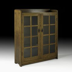 GUSTAV STICKLEY  Double-door bookcase with three fixed shelves, Eastwood, NY, ca. 1908