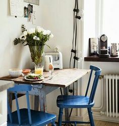 blue chairs, flowers, and a simple solo breakfast