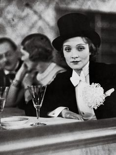 fantomas-en-cavale:    Alfred Eisenstaedt- Marlène Dietrich in tuxedo and top hat at a ball for foreign press, 1930's