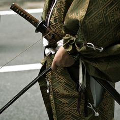 Samurai - I like this picture because it portrays the samurai with no only his katana, but his yumi as well, the original weapon of the samurai. Usually pictures only have them with katanas....