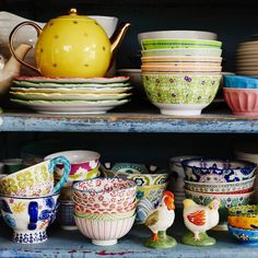 Louise Matthew's kitchen shelves feature a pretty colourful mix of orange, green, blue and yellow crockery.