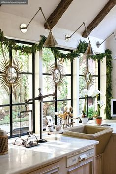 garland & sunburst mirrors decorate the windows