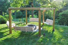 Porch Swing Fire Pit Pergola (with plans)... I want to do a circle of gravel around mine, though, so no one has to try to get in there with the lawn mower/weed eater