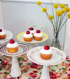 I am really pinning this just bc I want to eat all those cupcakes! But I liked the idea someone had...Recycled cake stands.  For the bridal shower, ask guests to bring a tea saucer and a candle stick.  Spend the next day doing this DIY project, and you have gorgeous, eclectic cake stands to display desserts at the wedding!