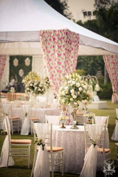 Wedding Decor - Pink and White Floral Decor | WedMeGood Pastel Decor with White Seat Arrangement and Centre Floral Tablepiece #wedmegood #indianwedding #decor #DIY #white #pastel
