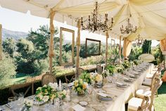 love the idea of floating frames and chandeliers for an outdoor party