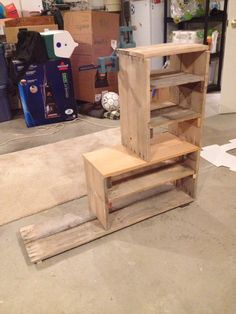 Pallet shoe rack. Made from rough pallet wood & a few pieces of oak from a platform bed we had to saw in half to get through the front door of the condo. Ahh memories....