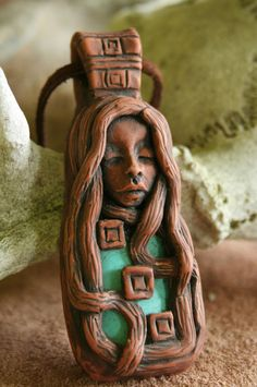 Hand sculpted Polymer clay face pendant with by FaceARTifacts