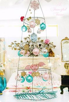 Christmas tree is made from a tomato cage. I think I would spray it white or gold but what a great way to display those special ornaments.