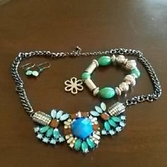 Necklace, bracelet, & earrings Statement necklace with blue, green, & clear accents. Earrings are dangle with green stones. Bracelet is silver & green with a stretchy band. Jewelry
