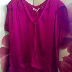 """100% silk Rebecca Taylor tunic. NWT.  Magenta. Silk tunic size 6. Magenta. """"Charmeuse tee"""" from Rebecca Taylor. Gorgeous. Soft. I wear a size 10 usually or an 8 but this fits me perfectly and is little roomy so it flows nicely on me. So I'd say runs a little big. Has ties at neck you can leave untied or knot/bow them. Just noticed tiny tear at back of left shoulder. Price reflects this. Can't see it unless hold up to sunlight like I just did! Additional pics listed separately. Rebecca Taylor…"""
