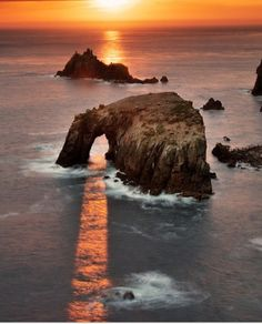 believe this is big sur which sun comes thru rock on pfeifers beach on winter solstice at sunset