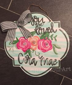 Welcome your sweet new baby girl home with this sweet floral hanger with a personalize scripture or quote. This piece is cut plywood, painted with acrylic paints, sealed with a heavy layers of clear coat and a twine hanger with pretty bow attached. Teacher Door Hangers, Hospital Door Hangers, Baby Door Hangers, Wooden Door Hangers, Canvas Door Hanger, Wooden Door Signs, Wooden Doors, Floral Nursery, Kids Wood