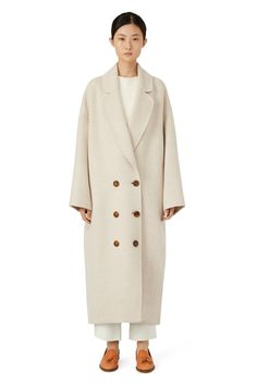 Italian wool beige oversized long coat. Double breasted six button closure and two side pockets. Fully double faced and unlined. Made in Italy.
