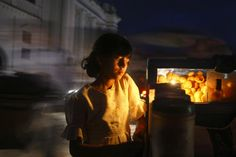 Sept. 10, 2012. A girl waits for her food after ordering it along the streets of Kathmandu.
