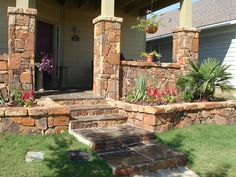 Wonderful outdoor area with flagstone columns: house exterior with red stone pillars flagstone floor and stairs there are also beautiful small plants
