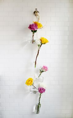 It's no secret that we love flowers here at the studio. We would probably have them on every surface of the house if we could, so we are always looking for cute ways to display pretty petals. We loved this hanging vase display, but the item was sold out before we could snag it, so we decided to find a way to recreate it ourselves. Here's what we did to make a similar look of our own: