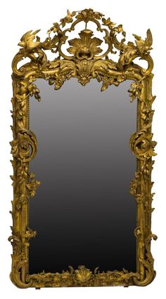 """Monumental Louis XV style giltwood wall mirror, possibly period, large pierced crest with birds and roses, applied flowering and fruiting vines and swags, along beaded border frame, encasing rectangular flat mirror, paneled backboards, intact restorations, some loss to gesso, some silvering loss, approx 96""""h, 52""""w Start Price: $1500.00"""