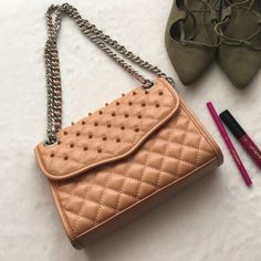"Rebecca Minkoff mini affair Studded 🚫🅿️🅿️🚫TRADES‼️ Trendy Quilted bag, from Rebecca Minkoff. Tan color. Top convertible single/double chain, studded foldover flap with magnetic closure. Allover quilted construction. Interior slip wall pocket Dust bag included. Approx. 6.5"" H x 8.5"" W x 2"" D Approx. 11"" double strap drop, 21.5"" single. Has minor scratches at bottom but not noticeable, and a small dark spot at bottom again not noticeable in excellent condition. Rebecca Minkoff Bags…"