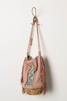 Love this fringed basket weave bag $238