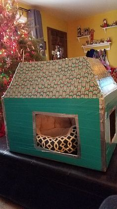 Cardboard box turned kitty house, cut holes, tape the top to look like a roof, add duct tape and washi tape to decorate