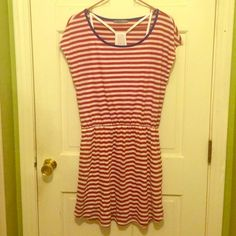 Red and white striped dress Lightweight spring/summer dress. Red and white striped with blue neckline trim. Cinched at the waist. Little white tank top attached to inside. So cute and comfy! Smartset Dresses