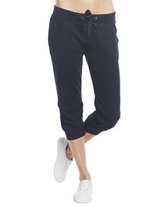 """Super cute jogger pant to run through the trails or rock with high heels for a sporty chic look! It features a short capri construction, solid french terry knit body, banded leg openings, and an elasticized waist band with adjustable drawstrings.  Model is 5'9"""" and wears a size small   20"""" Inseam 10"""" Leg Opening 60% Cotton / 40% Polyester Machine Wash Imported"""