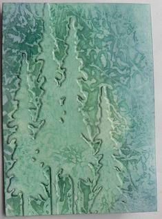WRINKLED WAX PAPER OVER GLOSSY CARD STOCK INSIDE OF EMBOSSING FOLDER.  AFTER EMBOSSING USE HOT IRON FOR 20-30 SECONDS OVER WAX PAPER & REMOVE.  SPONGE ON DISTRESS INKS.