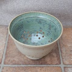 Berry bowl or colander hand thrown in stoneware ceramic pottery by Caractacus Pots on Gourmly