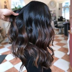NATURAL LOOKING DARK BROWN HIGHLIGHTS Our next highlight idea would work with brown and black hair. As you can see, the hair is very dark at the top and then blends into a chocolaty shade. If you wanted a bolder blend, you can add in a lighter color to Highlights For Dark Brown Hair, Brown Hair Balayage, Brown Blonde Hair, Light Brown Hair, Hair Color For Black Hair, Brown Hair Colors, Chocolate Highlights, Black Hair With Lowlights, Dark Chocolate Brown Hair