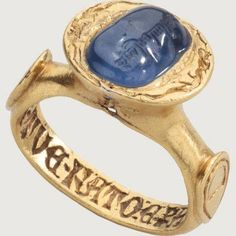 MEDIEVAL INSCRIBED SAPPHIRE RING. Italy, late 14th century; sapphire with Islamic inscription, 10th century. Gold and sapphire.