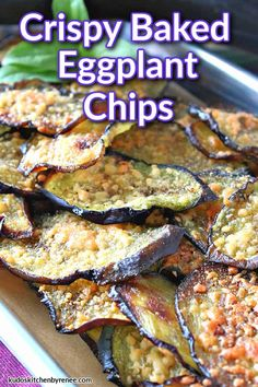 These delicate but Crispy Baked Eggplant Chips are packed with flavor thanks to a light brushing of homemade basil-infused olive oil, and grated Parmesan cheese. #eggplant #eggplantchips #vegetablechips #appetizer #easyappetizer #vegetarianrecipe #parmesancheese #roastedeggplant #vegetablesnacks #plantbasedrecipe #lowcarbsnacks #ketosnacks #kudoskitchenrecipes #cookingwithfreshbasil #infusedoliveoil #auberginechips #bakedauberginechips Eggplant Chips, Baked Eggplant, Vegetable Chips, Vegetable Snacks, Eggplant Sandwich, Appetizer Recipes, Appetizers, Low Carb Casseroles, Kitchen Recipes
