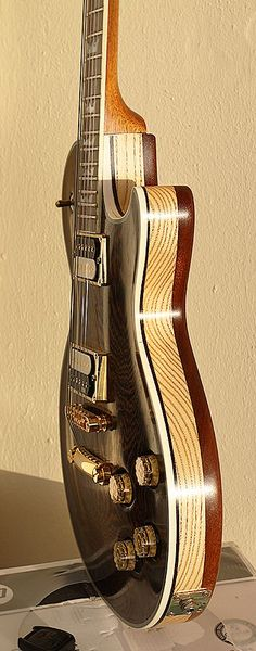 My First Handmade Guitar. AMG Saucy Beauty - Gibson Les Paul Style Guitar. Follow me on YouTube Channel: http://www.youtube.com/?utm_content=bufferd1077&utm_medium=social&utm_source=pinterest.com&utm_campaign=buffer...