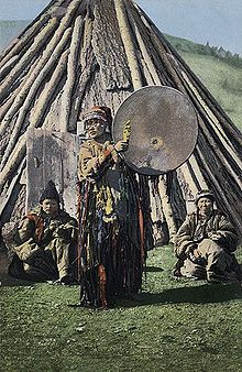 Russian postcard based on a photo taken in 1908 by S. I. Borisov, showing a female shaman, of probable Khakas ethnicity.