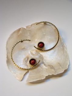bronze earrings with patina and coral