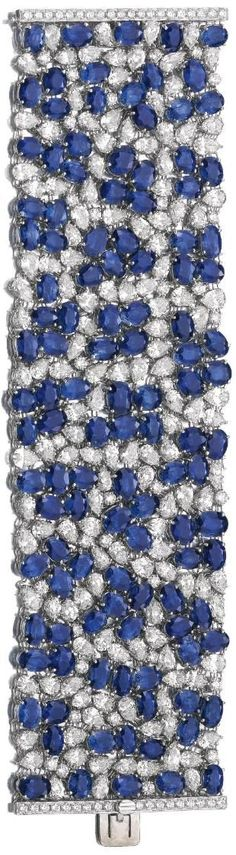 Wide sapphire and diamond bracelet. Via Diamonds in the Library.