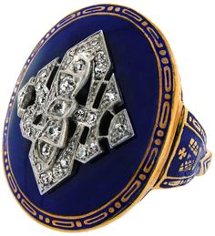 Art Deco Diamond and Enamel Signet Ring, circa 1920s. Visually strong, this large Art Deco ring features royal blue enamel with champlevé details. The applied diamond-set monogram is wonderfully layered and sleekly geometric. Via 1stdibs.