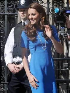 """Image detail for -The royal baby rumors are going strong after Kate Middleton arrived at the Olympics-themed """"Road to 2012: Aiming High"""" event wearing a loose-fitting blue dress ..."""