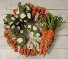 Natural colored burlap with 3 burlap carrots and carrot accent bow. This wreath measures 18 in diameter. *Each wreath is handmade and may differ slightly from the picture. I strive to make each wreath full and even* (Please Note--As with most wreaths, it is best to hang this