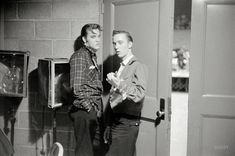 May 27, 1956. Dayton, Ohio. Elvis Presley with his cousin Gene Smith backstage at the University of Dayton field house, on the threshold of superstardom.