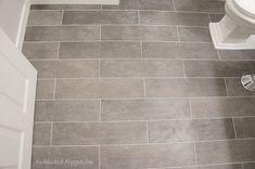 Plank bathroom floor tiles. I want this for my bathroom floor. It looks like a lot of work though.