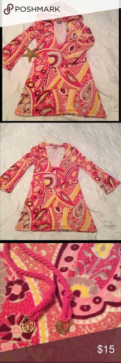 """Juicy Couture Terry Cover Up Paisley PINK!!!!  Excellent condition bright and fresh  Super soft and stretchy hooded terry cover up ties in front with cute gold toned  butterfly charms,  has large pocket in front. Size P this could even be for a small-medium person a warm cover up for your bikini. Could double for Lilly Pulitzer. Measures 30"""" long, 18"""" bust Like and follow me in the PINK HIVE!!!!!! Pet and smoke free closet. Juicy Couture Swim Coverups"""