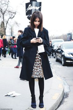 Love the contrast of the dark coat with the leopard skirt - LA COOL & CHIC