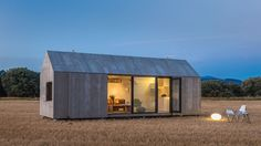 Sunset view of Abaton Arquitectura's 27-square-meter portable house.