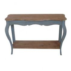 """Showcase a bouquet of fresh blooms or a vignette of framed photos on this charming wood console table, featuring a blue finish and lower display shelf.  Product: Console tableConstruction Material: WoodColor: Blue and naturalFeatures: Scalloped apronLower display shelf Dimensions: 30"""" H x 40"""" W x 13"""" D"""