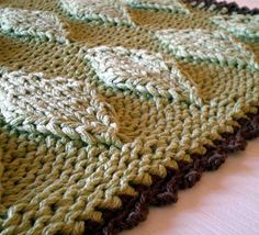 Free Knitting Pattern Puffy Diamonds Bath Mat - Sarah Keller's entrelac rug is knit with 3 strands of yarn held together. This is one of the patterns from the book 101 Designer One-Skein Wonders